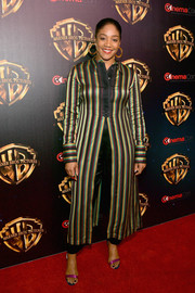 Tiffany Haddish paired a long striped tunic with satin pants for CinemaCon 2019.