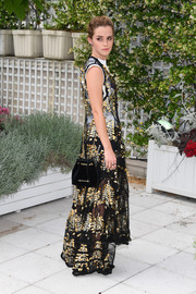 Emma Watson paired a black chain-strap velvet bag by M2Malletier with a sheer gown for the 'Circle' photocall in Paris.