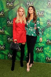 Lottie Moss cut a chic figure in a little red wrap dress at the premiere of 'Cirque du Soleil OVO.'