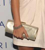 Jessica was a golden sensation with a hard case clutch.