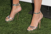 Selena Gomez wore a metallic silver strappy platform sandal with clear detailing