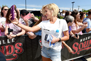 Savannah Chrisley completed her casual outfit with distressed jean shorts.