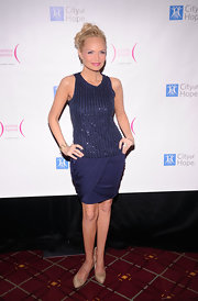 Kristin Chenoweth looks perfectly polished in nude pumps paired with a bead embellished navy blue cocktail dress.