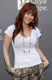 Actress Sara Rue paired her basic white V-neck with a Runway Long Necklace with black diamond crystals in matte silver and matte gold.