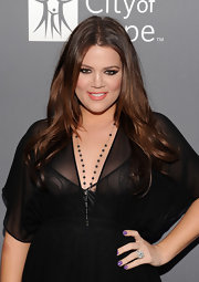 Khloe Kardashian styled her brunette hair in a center part waves at the 2011 Spirit of Life Awards.