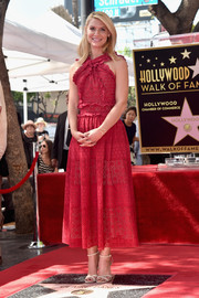 Claire Danes looked captivating in a red Oscar de la Renta frock, boasting an ultra-feminine blend of ruffles and eyelets, during her Hollywood Walk of Fame ceremony.