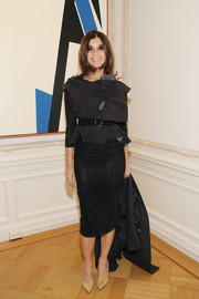 Carine Roitfeld teamed a basic black pencil skirt with a tattered-chic blouse for the Clare Rojas Artist Reception.