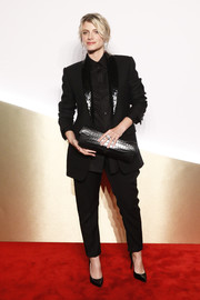 Melanie Laurent looked androgynous-chic in a black suit with shiny lapels at the Clash de Cartier launch.