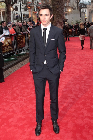 Nicholas Hoult showed off a classic navy suit while attending the 'Clash of the Titans' premiere.