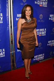 Mariska Hargitay wore a caramel asymmetrical cocktail dress to the 'On a Clear Day You Can See Forever' red carpet.