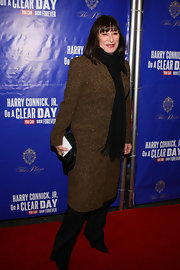 Angelica Huston wore a black pashmina scarf with her elegant evening ensemble for the Broadway opening of 'On a Clear Day You Can See Forever.'