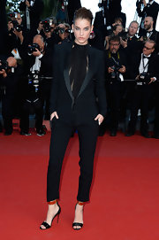 Barbara Palvin chose a very sleek menswear-inspired look with this black tuxedo-style pantsuit.