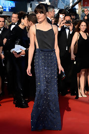 Milla Jovovich kept her look totally sleek and sexy with this gown that featured a spaghetti strap top and an embellished navy skirt.
