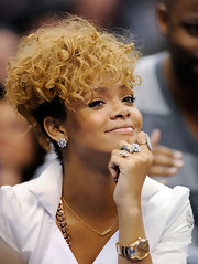 While sitting court side at the Laker game, Rihanna showed off her finger tattoo, which reads 'Love'.