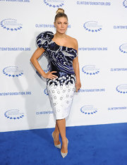 Fergie is always the daring fashionista. The stunning songstress stepped onto the blue carpet in a one-shoulder ruffled cocktail dress for the Decade of Difference Gala.