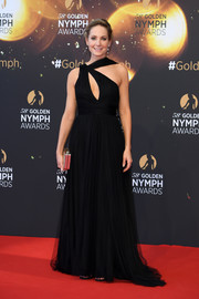 Joanne Froggat worked an asymmetrical black gown with a keyhole cutout at the 2018 Monte Carlo TV Festival closing ceremony.
