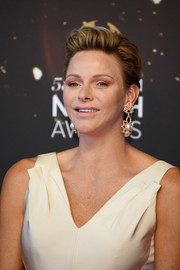 Charlene Wittstock went for a glamorous finish with a pair of dangling pearl earrings.