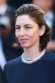 Sofia Coppola styled her navy dress with a stunning ruby and diamond collar necklace by Chopard.