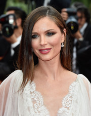 Georgina Chapman went for sleek styling with this straight side-parted style at the Cannes closing ceremony.