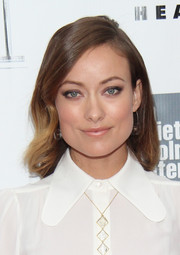 Olivia Wilde opted for a simple side-parted 'do with subtle waves when she attended the gala presentation of 'Her.'