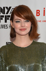 Emma Stone wore her hair in her signature bob with side parted bangs to the 52nd New York Film Festival.