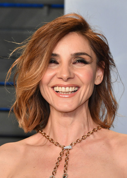 Clotilde Courau Shag [oscar party,vanity fair,hair,face,hairstyle,facial expression,eyebrow,chin,lip,smile,blond,beauty,beverly hills,california,wallis annenberg center for the performing arts,radhika jones - arrivals,radhika jones,clotilde courau]