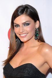 Alyssa Miller played up her green eyes with emerald green dangle earrings at the Club SI Swimsuit event in Las Vegas.