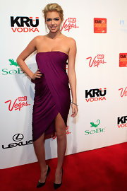 Kate Upton topped off her draped purple dress with black leather stilettos.