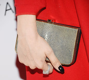 Francesca Eastwood complemented her red dress with a printed hard-case clutch when she attended the Club Tacori event.