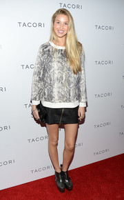 Whitney Port was edgy-sporty at the Club Tacori event in a snakeskin-print crewneck sweater teamed with a zippered mini skirt.