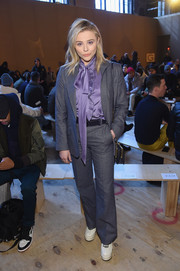 Chloe Grace Moretz went for an androgynous vibe in this gray pantsuit and lavender pussybow blouse combo by Coach during the brand's fashion show.