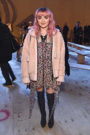 Maisie Williams added some warmth with a hooded pink fur jacket.