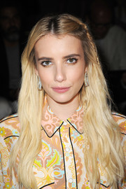 Emma Roberts looked pretty wearing this partially braided hairstyle at the Coach 1941 fashion show.