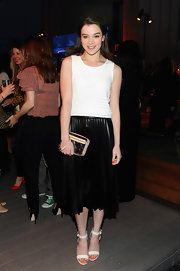 Hailee Steinfeld rocked a black pleated skirt at Coach's Evening of Cocktails and Shopping.