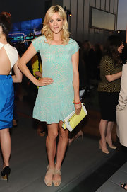 Georgia King chose a fun and flirty frock in a bright teal color for her look at Coach's Evening of Cocktails and Shopping.