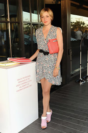 Chloe Sevigny chose a delicately printed frock with a bow belt and V-neck line for her look at Coach's CDF event.