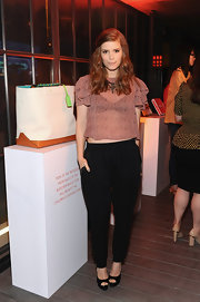 Kate Mara looked sexy while still being conservative when she opted for this sheer cropped blouse, which featured loose ruffled sleeves.