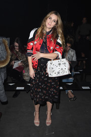 Drew Barrymore kept it youthful in an embroidered varsity jacket by Coach during the label's 75th anniversary show.