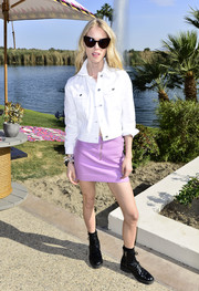 Mary Charteris added a lovely pop of color with a purple mini skirt.