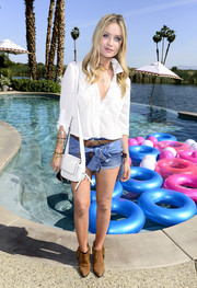 Laura Whitmore soaked up the sun in a white button-down during a Coachella party.