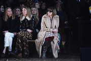 Anna Wintour kept warm in style with a nude fur coat at the Coach fashion show.