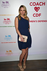 Jennifer Morrison carried the lovely champagne Kristin Embossed Python Crossbody bag as a clutch.