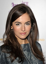Camilla Belle shined on the red carpet at the Children's Defense Benefit with a side swept straight hairstyle.