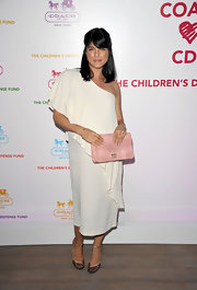 Selma Blair carried a darling pink gathered leather Madison clutch.