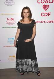 Alyssa wore a black silk maxi dress with a screen printed hem for the Children's Fund Benefit.