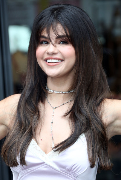 Selena Gomez attended a Coach meet-and-greet wearing a flowing 'do with wispy bangs.