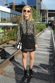 Kiernan Shipka kept it modest in a long-sleeve monochrome floral blouse by Coach when she attended the label's fashion show.