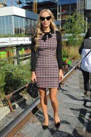 Harley Viera-Newton looked sweet in her gingham-print mini dress at the Coach fashion show.