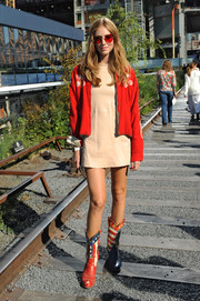 Chiara Ferragni styled her mini with a vintage red zip-up jacket.