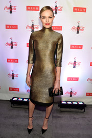 Kate Bosworth served up some futuristic glamour in a gold turtleneck dress by Angel Sanchez during the 'Coca-Cola Bottle: An American Icon at 100' exhibition.